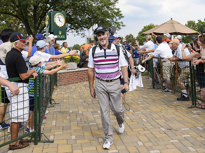 In his last broadcast for CBS Sports, commentator David Feherty walks to the 10th hole tee box during the final round of The Barclays at Plainfield Country Club.