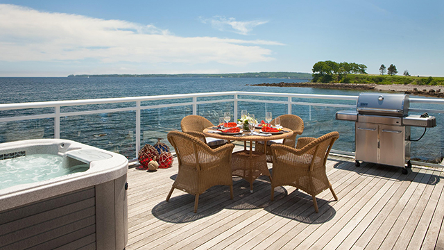 The cottage boasts a private outdoor deck with hot tub.