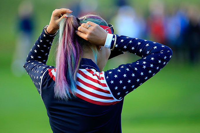 Michelle Wie of the United States Team shows off her colored hair.