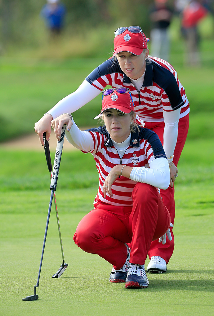 Paula Creamer and Morgan Pressel of the United States line up a putt on the 15th hole. They won 3 and 2 over Europe's Anna Nordqvist and Suzann Pettersen.