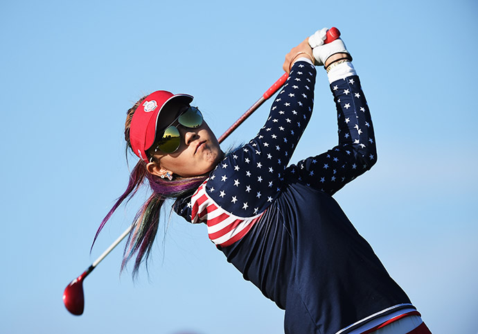 Michelle Wie of Team USA plays a shot during the morning foursomes.