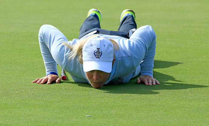 Suzann Pettersen of Team Europe gets a 'worm's eye' view of her putt on the 15th green.