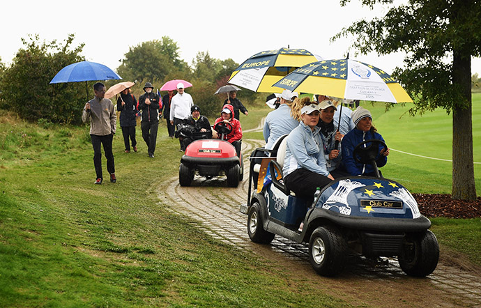Players of team Europe are take off the course in buggies due to a rain delay during the afternoon fourball matches.