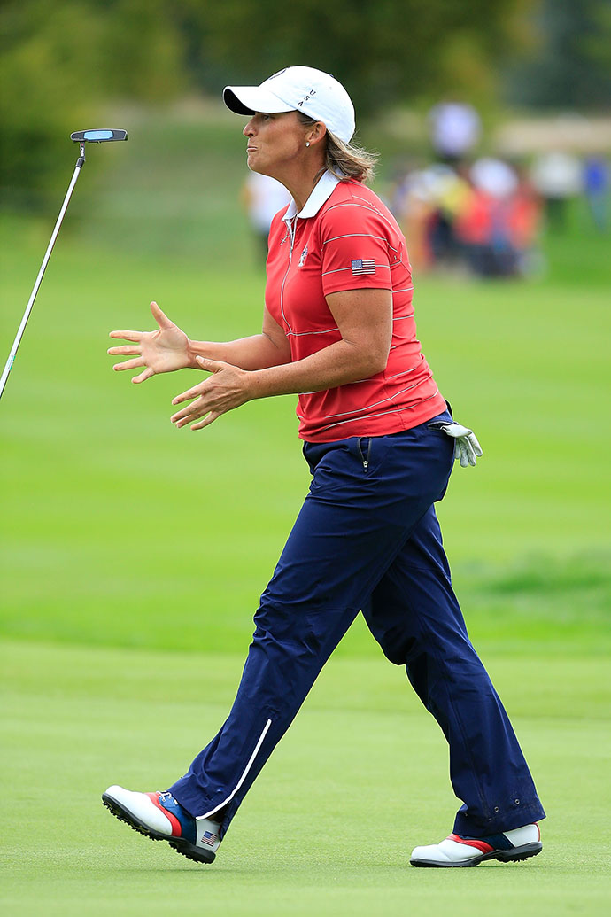 Angela Stanford of the Team USA reacts to missing a birdie putt at the 9th hole during the afternoon fourball matches, which they lost 3 and 2 to Hull and Nocera.