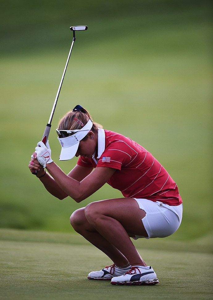Lexi Thompson of Team USA reacts to her missed putt during the afternoon fourball matches. She and partner Cristie Kerr will finish their last hole against Ciganda and Reid, when play resume Saturday, due to darkness.