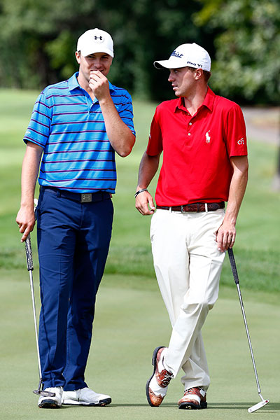 Jordan Spieth (L) talks to Justin Thomas on the second green during the Third Round of the BMW Championship at Conway Farms Golf Club on September 19, 2015 in Lake Forest, Illinois.