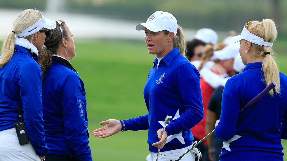 Suzann Pettersen of the European team tries to explain to her captain Carin Koch the length of putt that she did not concede to Alison Lee on the 17th green during the 2015 Solheim Cup.