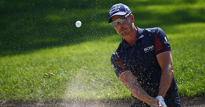 Henrik Stenson plays a shot from a bunker on the first hole during the round one of the 2015 BMW Championship.