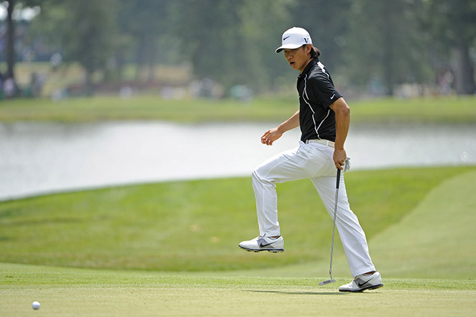 Anthony Kim reacts after missing a birdie putt on the 16th green during the third round of 2011 The Greenbrier Classic.