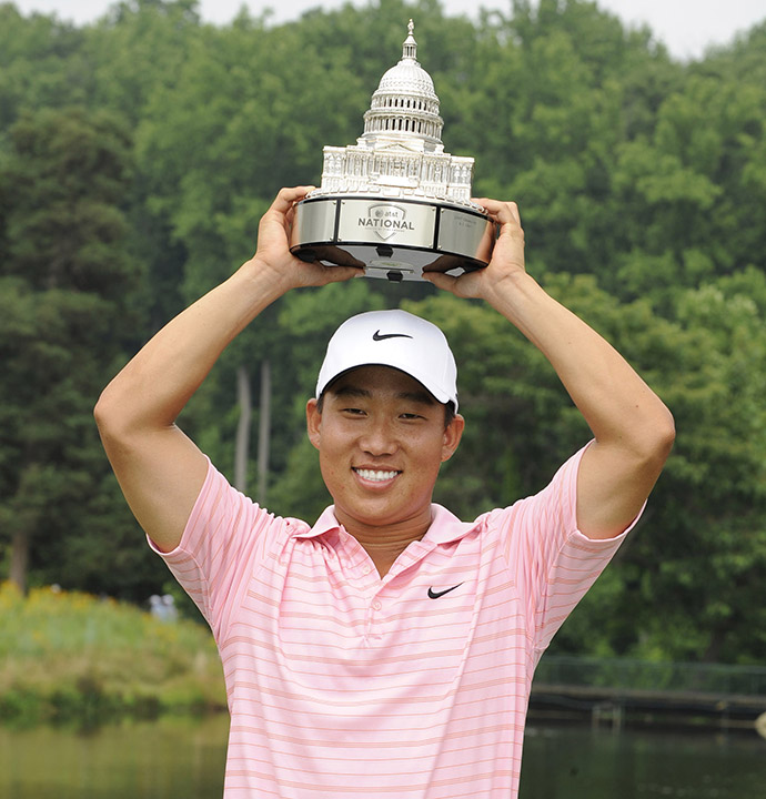 Anthony Kim holds the winner's trophy after the final round of the 2008 AT&T National.