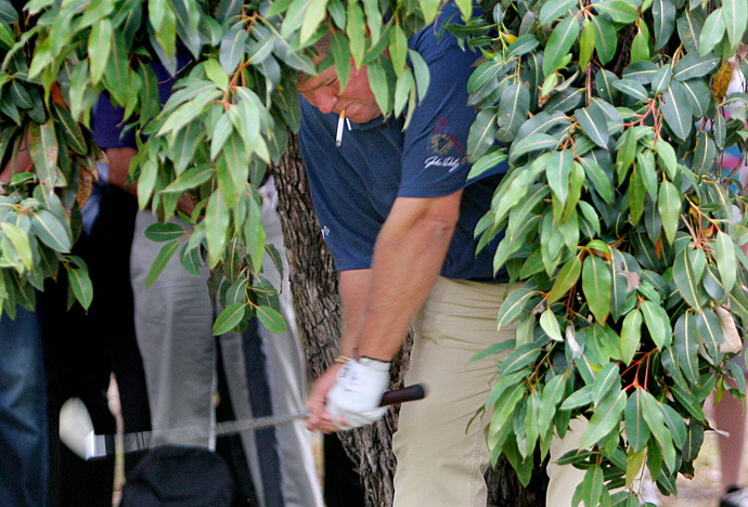 John Daily hits a shot while smoking a cigarette during the 2008 Australian Masters.