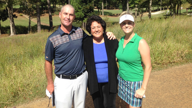 The author (right) with her husband and caddie Paul and Hall of Famer Nancy Lopez.