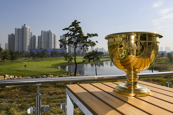 The Presidents Cup trophy is photographed over the fourth hole at Jack Nicklaus Golf Club Korea.