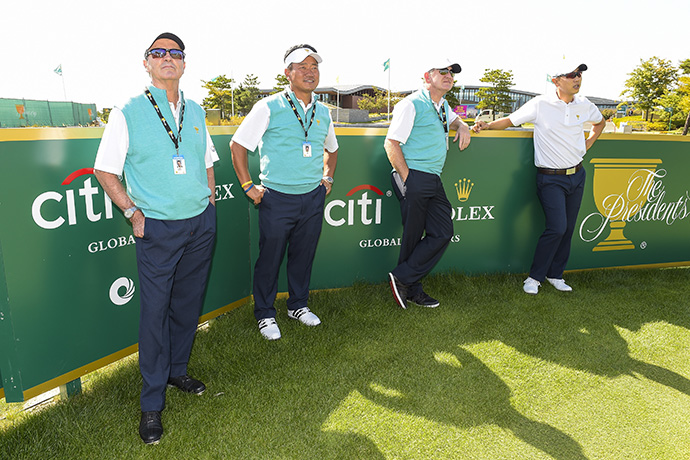 International Team Captain's Assistant Mark McNulty of Zimbabwe, Vice Captain K.J. Choi of Korea, Captain's Assistant Tony Johnstone of Zimbabwe, and Sangmoon Bae of Korea look on during practice for The Presidents Cup.