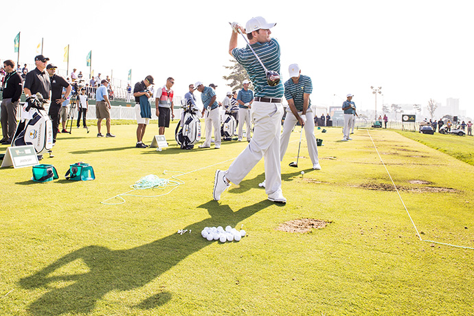 Branden Grace of South Africa on the International Team hits balls on the range during practice for The Presidents Cup.