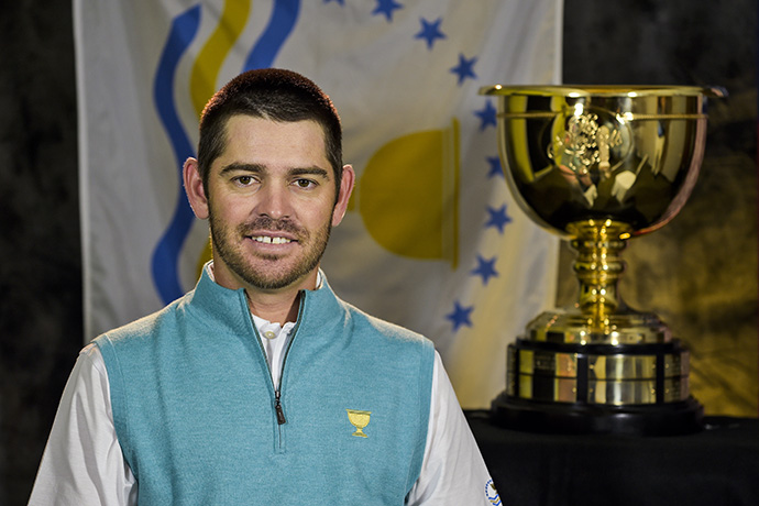 Louis Oosthuizen of the International Team poses for his headshot with the Presidents Cup trophy.