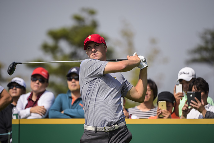 Fans watch as Jordan Spieth tees off on the sixth hole during practice for The Presidents Cup.