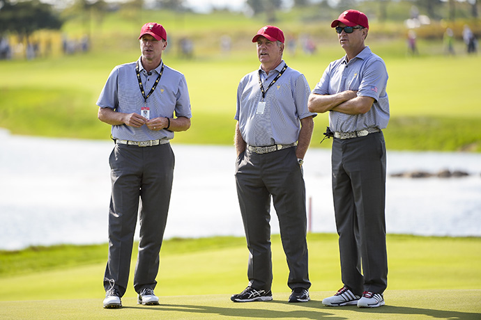 Team USA Captain Jay Haas, center, speaks with Captain's Assistants Steve Stricker, left, and Davis Love III during a practice round.