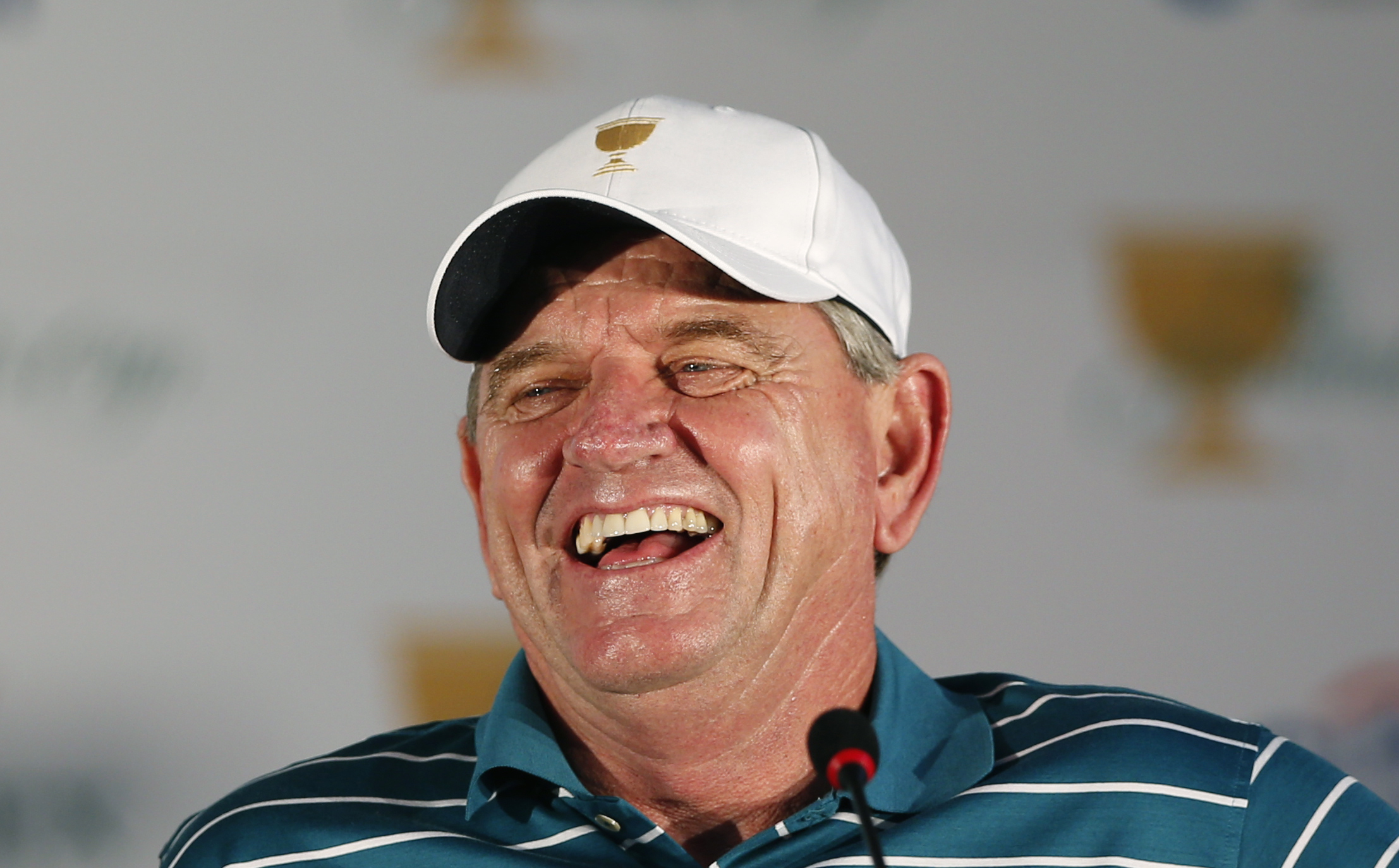 International team captain Nick Price smiles during a news conference ahead of the Presidents Cup golf tournament at Jack Nicklaus Golf Club Korea in Incheon, South Korea, Tuesday, Oct. 6, 2015. (AP Photo/Lee