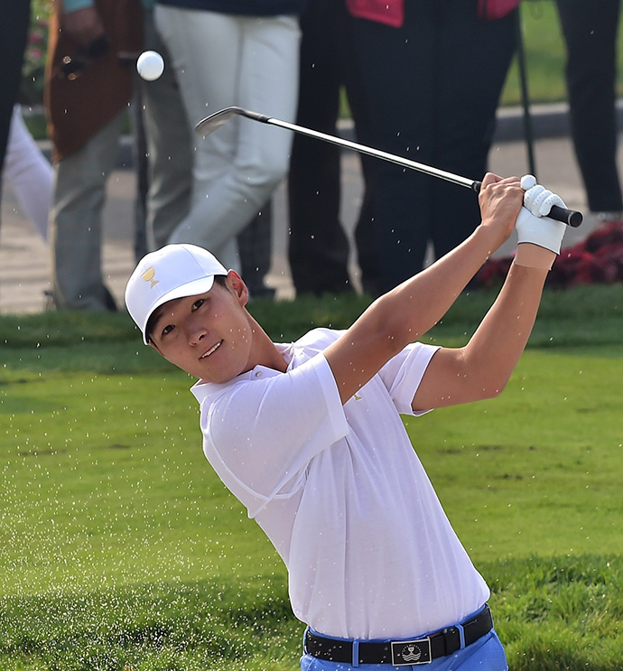 Danny Lee blasts out of a bunker during a practice session.