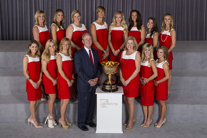 The wives and girlfriends of Team USA pose with Former President George W. Bush.