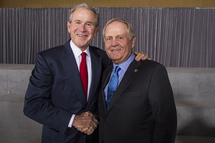 Former U.S. President George W. Bush poses with golf legend and course designer Jack Nicklaus during The Presidents Cup Opening Ceremony.