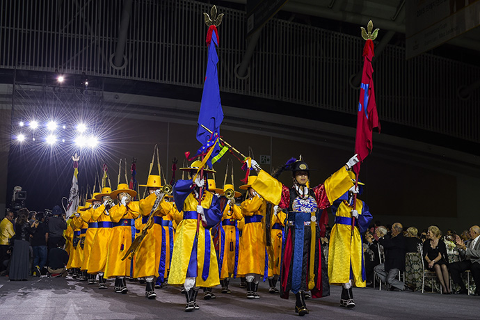 A traditional South Korean band leads a procession during The Presidents Cup Opening Ceremony.