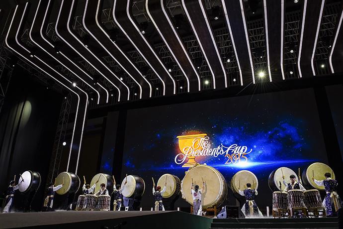 Drummers perform onstage during opening ceremonies.