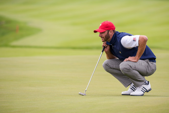 Dustin Johnson reads a putt on Saturday.