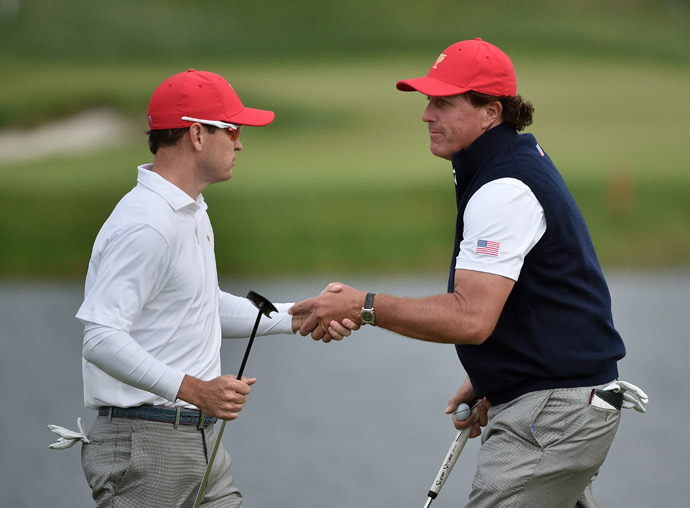 Phil Mickelson teamed with Zach Johnson to win their Saturday fourball match.