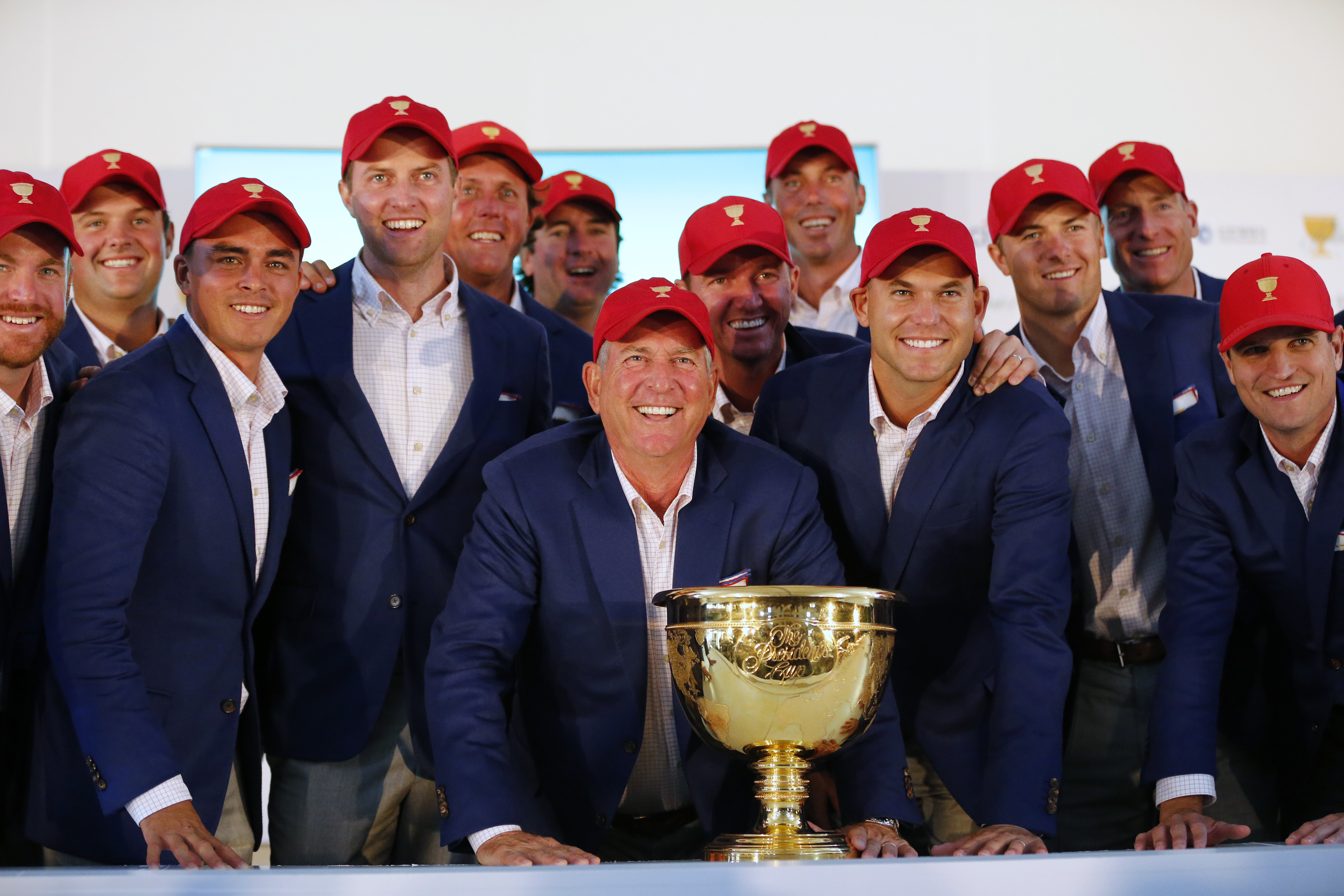US team captain Jay Haas, front centre, poses with his team after they defeated the International team 15.5 to 14.5 to retain the Presidents Cup at the Jack Nicklaus Golf Club Korea.