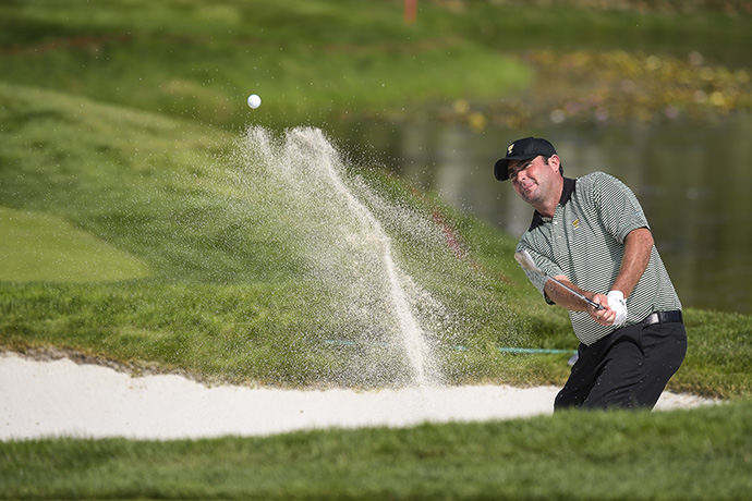 Steven Bowditch of Australia on the International Team hits out of a bunker on the seventh hole during the first round of The 2015 Presidents Cup.