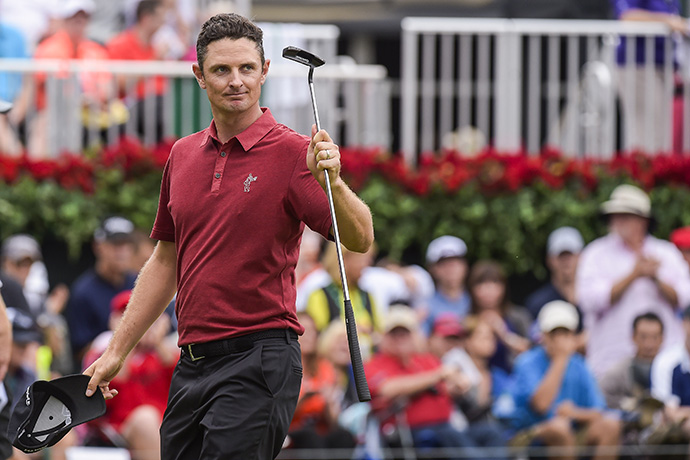 Justin Rose of England raises his putter to fans on the 18th hole green following the final round of the 2015 TOUR Championship by Coca-Cola.