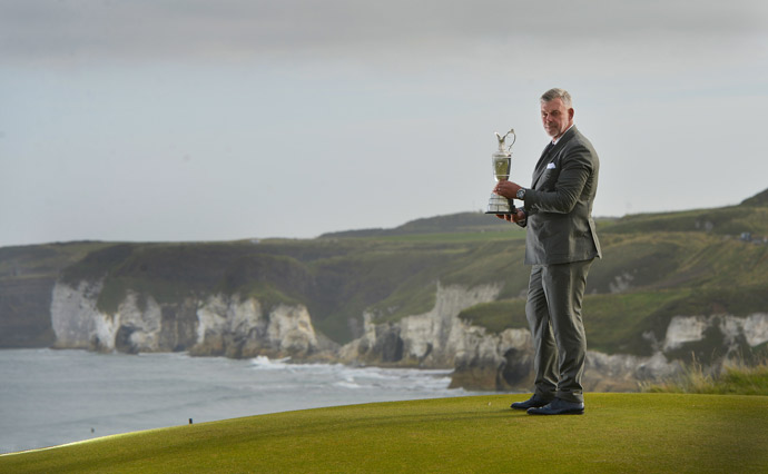 2011 Open Champion Darren Clarke poses with the Claret Jug at Royal Portrush.