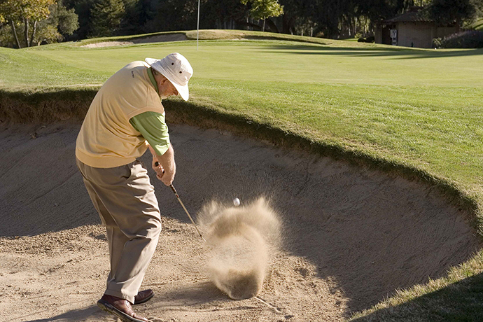 For 20- to 40-yard bunker blasts, hit chunks using a less-lofted club.