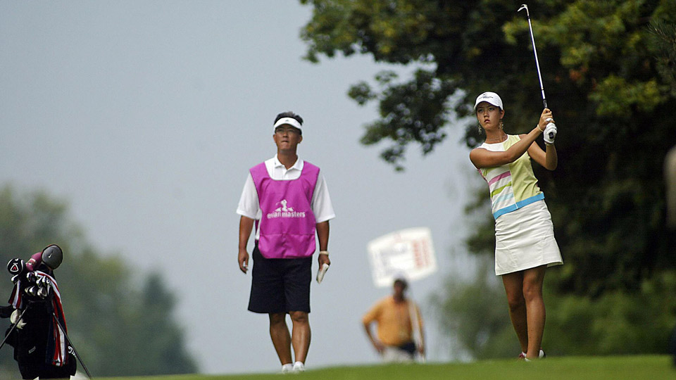 Michelle Wie with her father, B.J., at the 2004 Evian Masters in France.