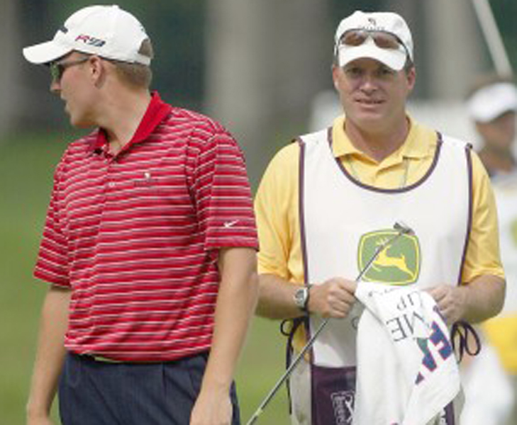 The author (right) caddies for Mike at the John Deere Classic.