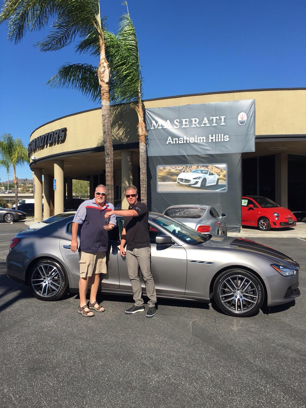 Kirk Williams picks up his new Maserati after scoring a hole-in-one at a charity golf tournament.