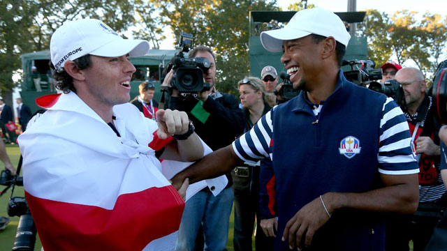 Rory McIlroy of Europe (L) and Tiger Woods of the USA greet each other on the 18th green after Europe defeated the USA 14.5 to 13.5 to retain the Ryder Cup during the Singles Matches for The 39th Ryder Cup at Medinah Country Club on September 30, 2012 in