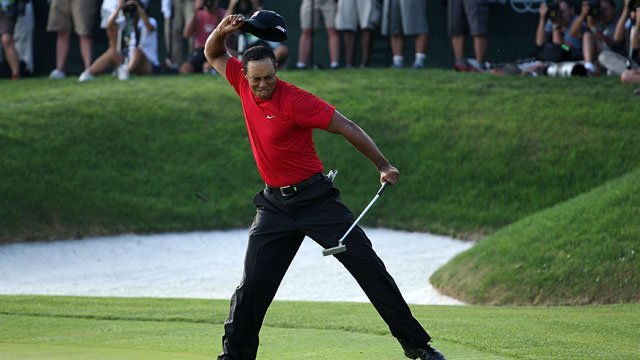 Tiger Woods celebrates making a birdie on the 18th green to win the Arnold Palmer Invitational on March 16, 2008 at the Bay Hill Club and Lodge in Orlando, Florida.