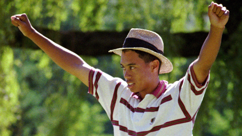 Tiger Woods celebrates after sinking the winning putt of the U.S. Junior Amateur in Portland, Oregon, on, July 31, 1993.