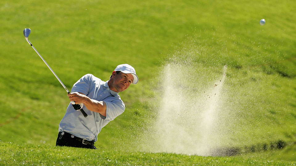 Mark Wahlberg hits out of a bunker on the tenth hole during the first round of the 2006 AT&T Pebble Beach National Pro-Am.