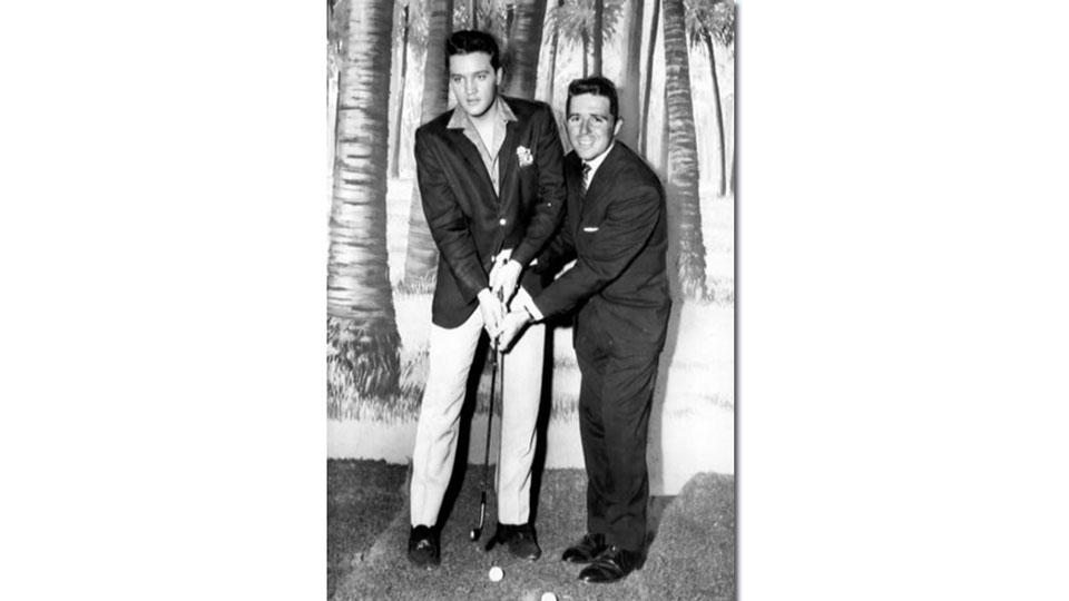 Gary Player gives some tips to Elvis Presley on the Paramount set of Blue Hawaii in 1961.