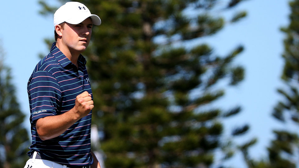 Jordan Spieth reacts after putting for birdie on the second green during the final round of the Hyundai Tournament of Champions at the Plantation Course at Kapalua Golf Club on Jan. 10, 2016, in Lahaina, Hawaii.