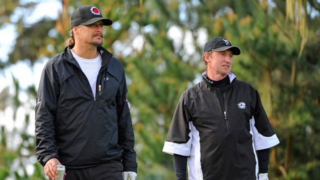 Recording artist Kid Rock and former NHL player Wayne Gretzky watch a shot on the 10th tee during the first round of the AT&T Pebble Beach National Pro-Am at Spyglass Hill Golf Course on February 6, 2014 in Pebble Beach, California.