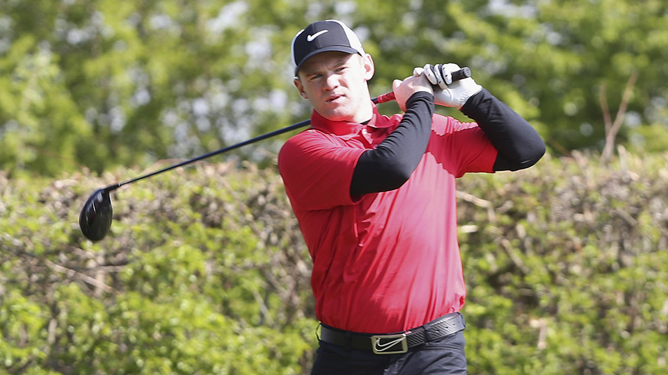 Wayne Rooney of Manchester United takes part in a Players v Coaching Staff golf match at Dunham Massey Golf Club on May 7, 2013 in Manchester, England.