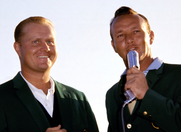 Jack Nicklaus smiles while Arnold Palmer talks during the presentation ceremony held at the conclusion of the 1963 Masters