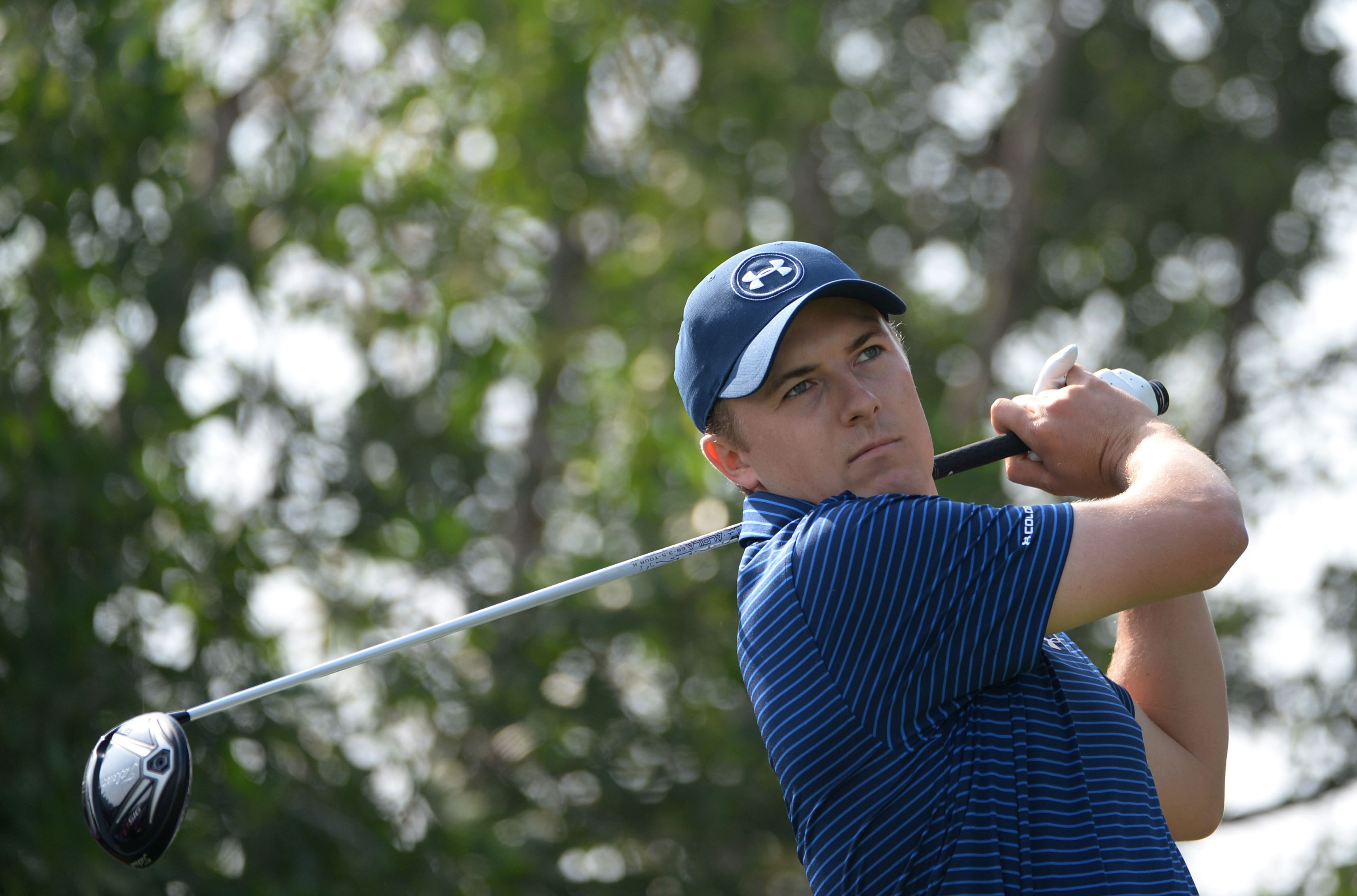 Jordan Spieth of the United States, the world number one, tees off at the 17th hole during the round two of the fog-delayed Abu Dhabi Golf Championship in Abu Dhabi, United Arab Emirates, Saturday, Jan. 23, 2016. (AP Photo/Martin