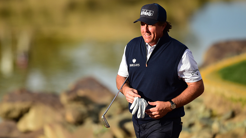 Phil Mickelson walks off the 17th green during the third round of the CareerBuilder Challenge In Partnership With The Clinton Foundation at the TPC Stadium course at PGA West on January 23, 2016 in La Quinta, California.