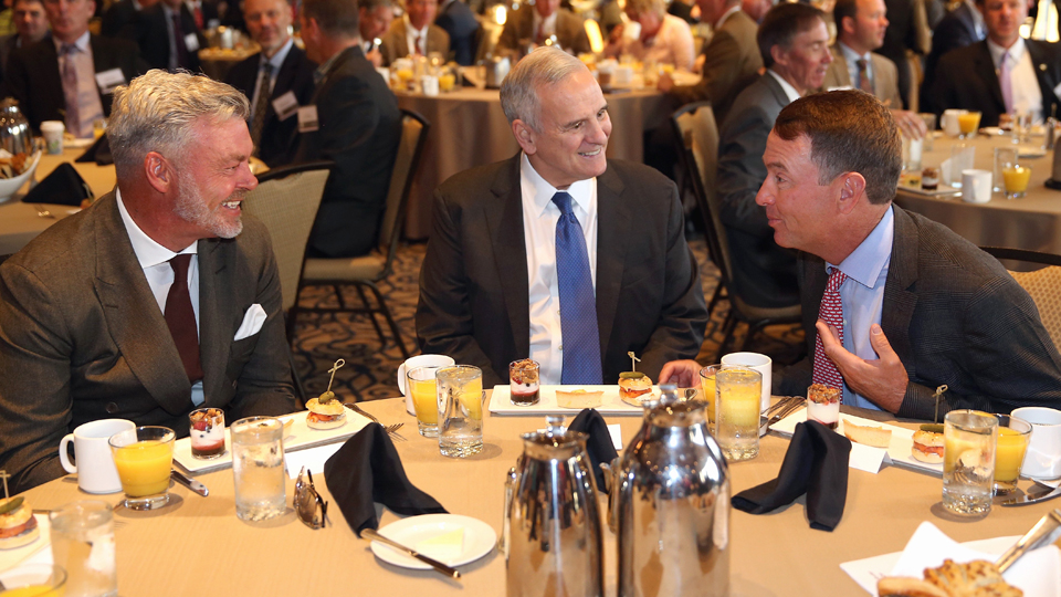 "Ryder Cup captains Darren Clarke (left) and Davis Love III (right) chat with Minnesota Governor Mark Dayton during the 2016 Ryder Cup ""Welcome To Minnesota"" Breakfast at the Windows on Minnesota building on Sept. 28, 2015, in Minneapolis, Minnesota."
